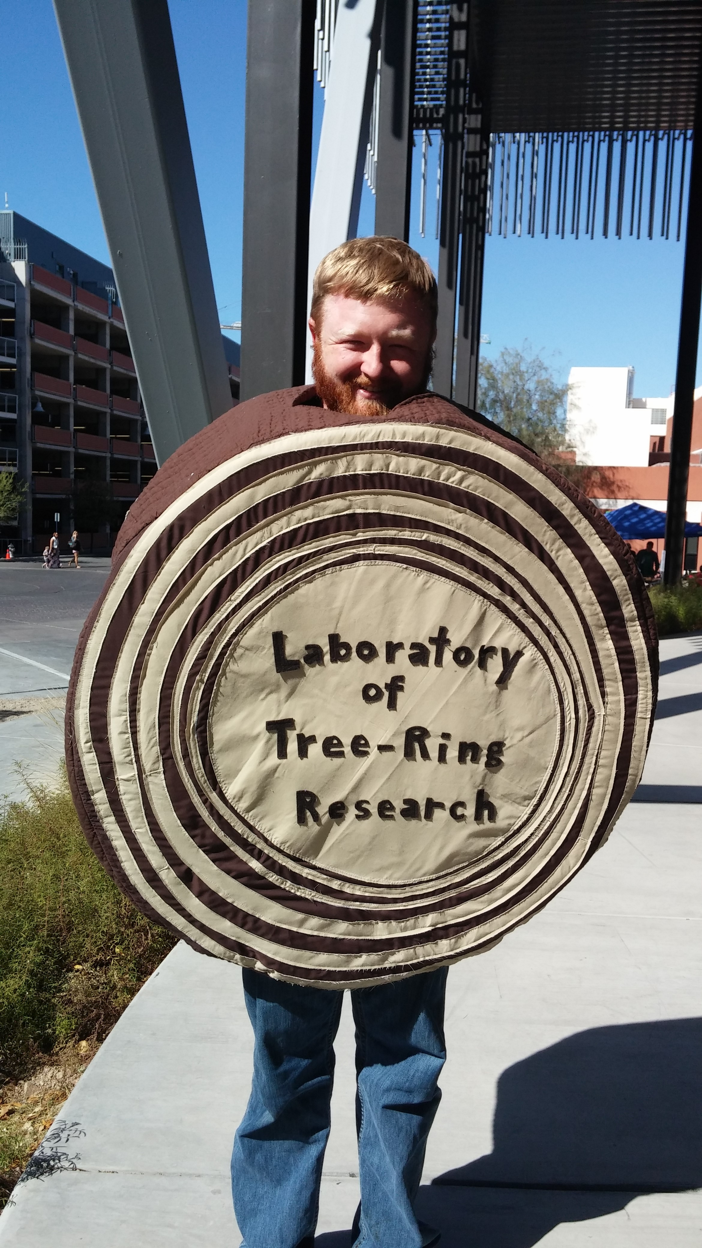 Volunteer in the tree-ring costume at a Tucson Festival of Books open house event.
