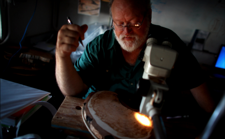 University of Arizona professor Tom Swetnam examines a tree sample at the Laboratory of Tree-Ring Research
