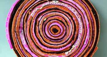Concentric strips of cloth resembling tree rings.